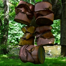 Charles Burch: smashed drums in a tree, ca
