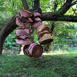 smashed drums in a tree - Charles Burch