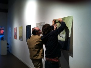 Lee Lippman (left) installing a past InLiquid show at the Painted Bride Art Center with Mat Tomezsko (right).