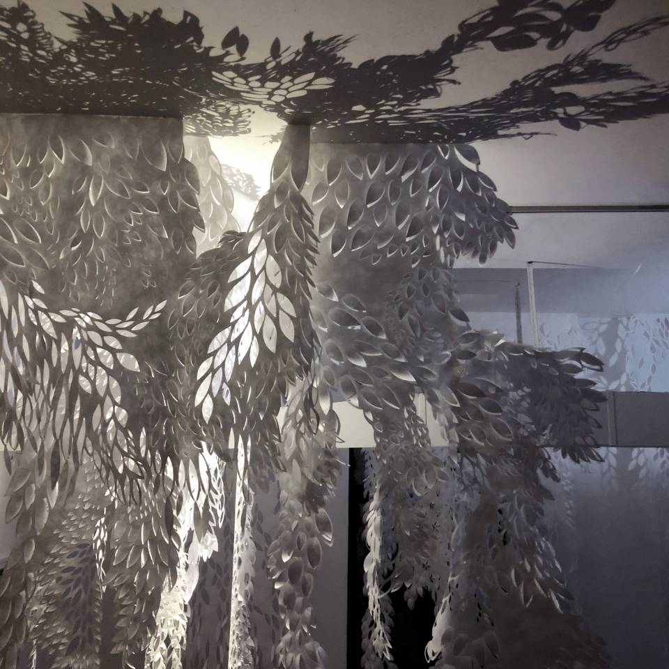 Influenced by folklore, superstition, divination, & forgotten territories reclaimed by nature, I create immersive installations out of hand-cut Tyvek—a nonwoven material most familiar as an insulating wrap used in the construction industry. These environments might be fairy-tale forests or the sites of biological disasters. Perhaps both.