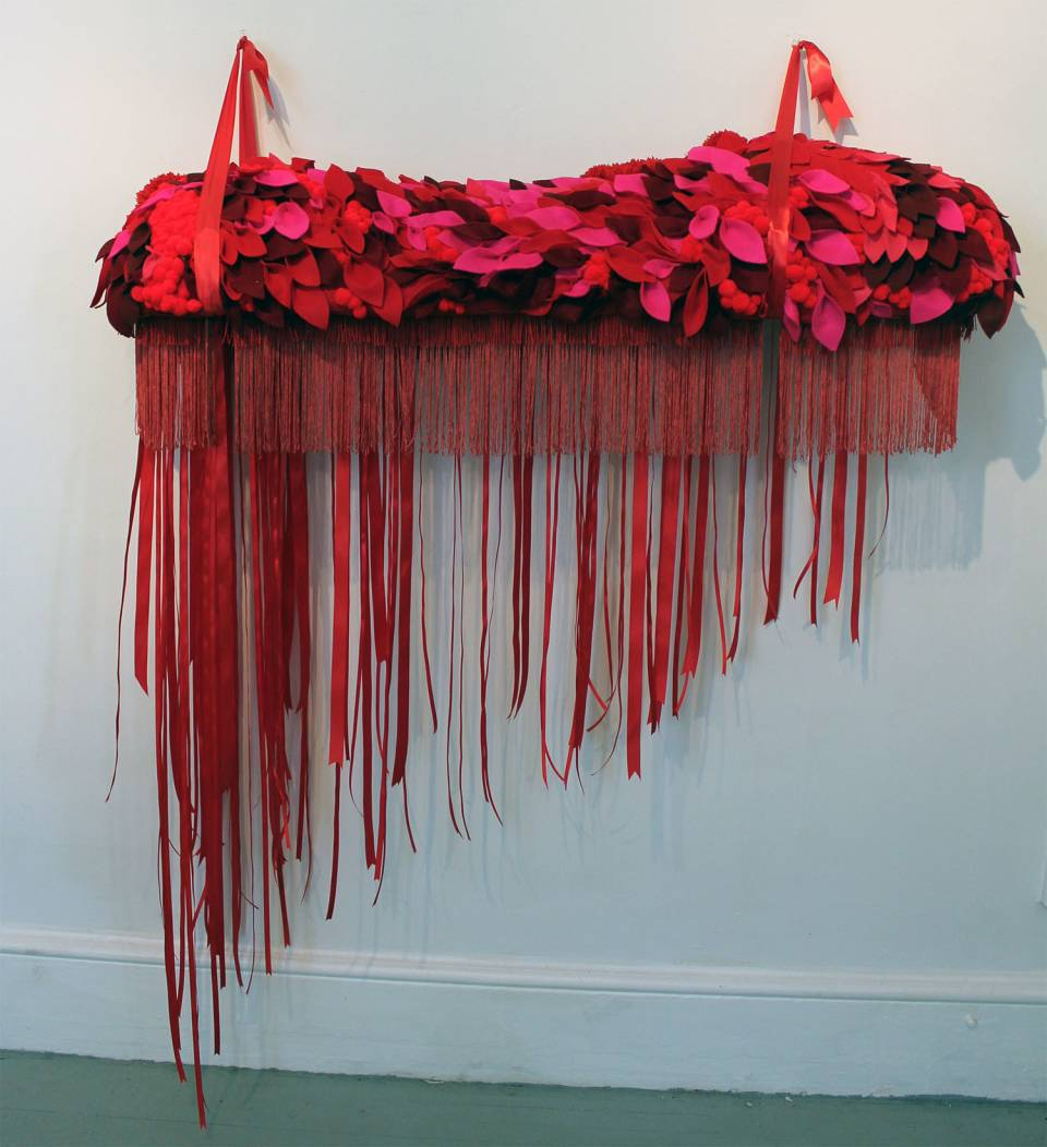 Carole Loeffler's red fiber and soft sculpture obsessively accumulated, stacked and sewn to replicate feelings of peace and awe.